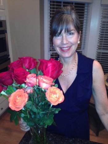 Karen Paul Holmes with roses