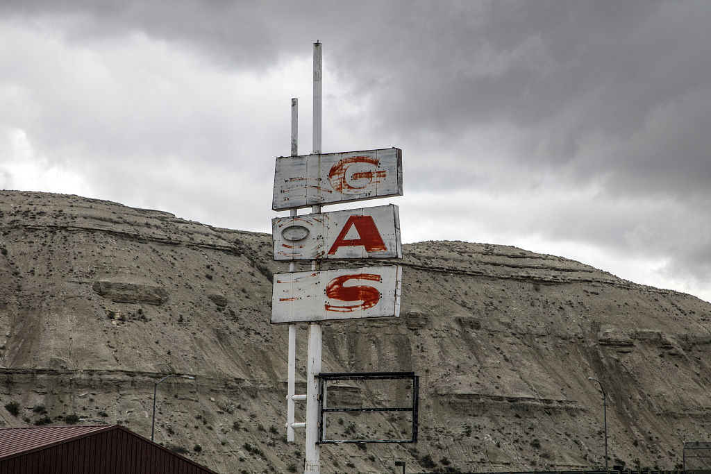 Forlorn sign for a long-closed gas station in Green River, Wyoming.